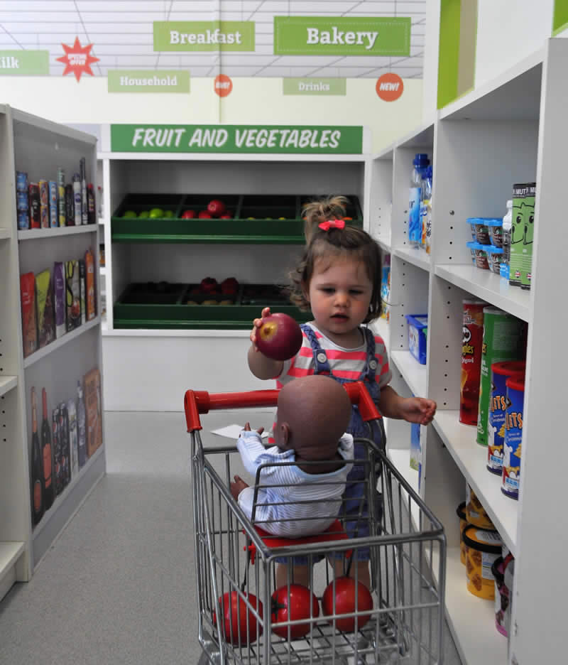 Grocery shopping, girl pretending to buy groceries, Little Street, Little Street Play Centre, Play Centre, Children Play Centre, UK play centre, children, childrens entertainment
